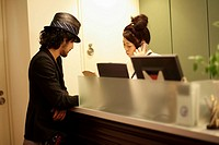 Hairstylists Standing at Reception Desk in Hairsalon