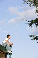 A man sitting on the roof