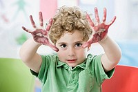 A boy with paint on his hands
