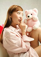 Woman playing with her teddy bear