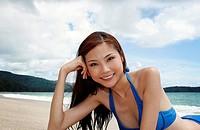 Woman in blue bikini flashing a smile at the camera
