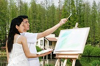 Woman watching her boyfriend painting