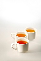 Close up of three cups of tea
