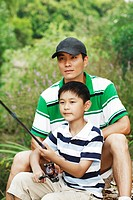 Father and son fishing by the lake side