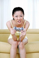 Woman playing video game console
