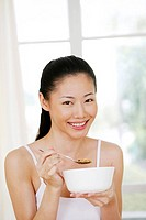Woman enjoying her breakfast cereal
