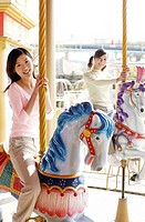Women riding on carousel