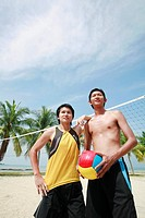 Man with volleyball posing with his friend