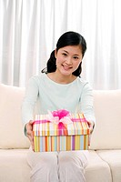 Woman holding a wrapped box