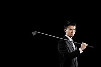 Businessman holding a golf club