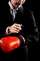 Businessman wearing boxing glove