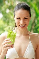 Woman holding a glass of herbal drink