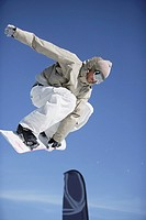 Snowboarder Juping a Barrier