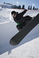 Snowboarder Riding a Half-Pipe
