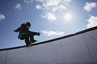 Snowboarder Railsliding