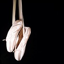 Ballet shoes on black background