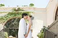 Newlywed couple kissing