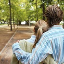 Young couple in park, rear view