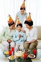 Boy celebrating birthday with his family