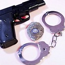 Gun, police badge and handcuffs