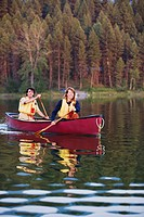 Couple canoeing outdoors