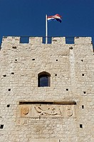 Main gate on the city wall. Korcula old town is a medieval walled city positioned on a oval_shaped swelling of land pointing deep into Peljesac Channe...