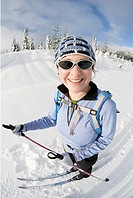 A woman cross-country skiing, Strathcona Provincial Park near Courtenay, BC, Canada
