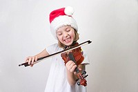 Girl - 6 years old playing violin in Santa hat
