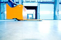 Worker on forklift inside warehouse, Weingarten, Baden_Wurttemberg, Germany