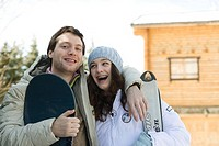 Young skier and snowboarder, smiling, portrait