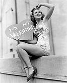 Woman holding a large valentine All persons depicted are not longer living and no estate exists Supplier warranties that there will be no model releas...
