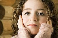 Girl holding head in hands, portrait