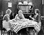 Three women sitting at the dining table talking All persons depicted are not longer living and no estate exists Supplier warranties that there will be...