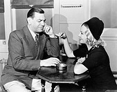 Profile of a man with a young woman smoking sitting in a cafe All persons depicted are not longer living and no estate exists Supplier warranties that...