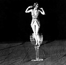 Tiny woman standing in wineglass All persons depicted are not longer living and no estate exists Supplier warranties that there will be no model relea...