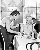 Couple in a restaurant having an argument over food All persons depicted are not longer living and no estate exists Supplier warranties that there wil...