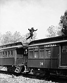 Man leaping across the roof of railroad cars All persons depicted are not longer living and no estate exists Supplier warranties that there will be no...