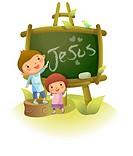 Boy writing Jesus on a blackboard