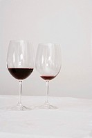 Close-up of two wine glasses on a dining table