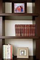 Close-up of books and picture frames in shelves