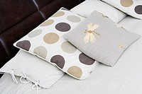 Close-up of cushions and pillows on the bed