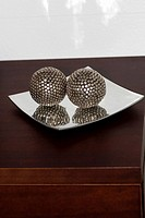 Close-up of two decorative balls in a tray