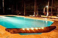 Swimming pool lit up at night