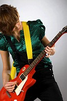 Close-up of a female guitarist playing a guitar