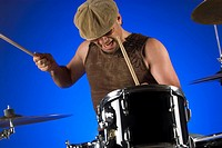 Male drummer playing drums