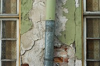 Close-up of a pipe mounted on a wall