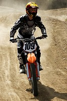 Motocross rider riding a motorcycle