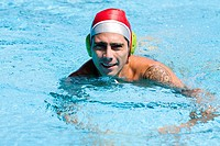 Portrait of a mid adult man swimming in a swimming pool
