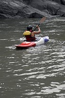 Rear view of a person kayaking in a river