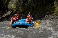 Five people rafting in a river